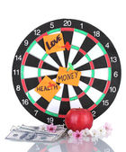 Darts with a stickers symbolizing love, health and money isolated on white — Stock Photo