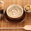 Tasty soup on wooden mat — Stock Photo #10339780
