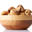 Delicious dried figs in wooden bowl isolated on white — Stock Photo