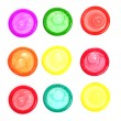 Постер, плакат: Colorful condoms isolated on white