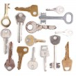 Many metal keys isolated on white — Stock Photo