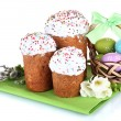Beautiful Easter cakes, colorful eggs in basket and flowers isolated on white - Photo