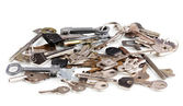 Lot of metal keys isolated on white — Stock Photo