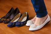 Woman in ballet flat shoes on wooden background — Stock Photo