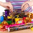Wrapping presents surrounded by  paper, ribbon and bows - Foto de Stock
