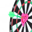 Darts with stickers depicting the life values close-up on white background - Stock Photo