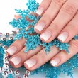 Beautiful hands and snowflakes and beads isolated on white - Zdjęcie stockowe