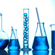 Test-tubes with blue liquid on blue background — Stock Photo