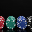 Stock Photo: Casino chips isolated on black