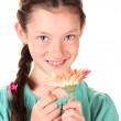 Portrait of beautiful little girl with gerbera flower isolated on white — Stock Photo