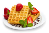 Belgium waffles with strawberries and mint on plate isolated on white — Stock Photo
