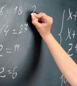 Hand writing on blackboard in class room — Stock Photo