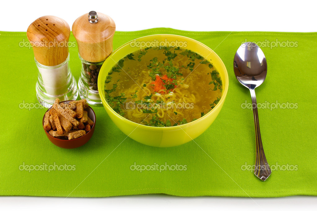 Tasty chicken stock with noodles on green tablecloth  Stock Photo #10360524