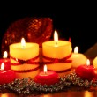 Beautiful candles and decor on wooden table on bright background - Stock Photo