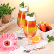 Fruit jelly in glasses and fruits on table in cafe — Stock Photo #10404900