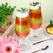 Fruit jelly in glasses and fruits on table in cafe — Stock Photo #10404912
