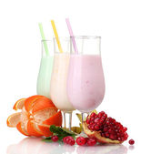 Milk shakes with fruits isolated on white — Photo
