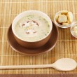 Tasty soup on wooden mat — Stock Photo