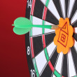 Darts with stickers depicting the life values close-up on colorful background - Zdjęcie stockowe