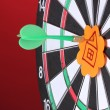 Darts with stickers depicting the life values close-up on colorful background - Foto de Stock