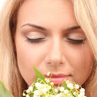 Beautiful young woman with lilies of the valley on white background close-up — Stock Photo #10414490