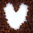 Pattern of heart on coffee beans background. Frame. — Stock Photo #10417498