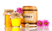 Sweet honey in barrel and jars with drizzler isolated on white — Stock Photo