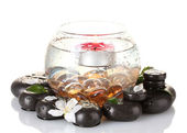 Composition of vase with candle and spa stones isolated on white close-up — Stock Photo