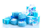 Beautiful gifts and babys bootees isolated on white — Stock Photo