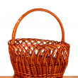 Empty wicker basket on wooden table — Stock Photo