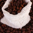 Coffee beans in canvas sack close-up - ストック写真