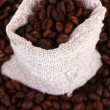 Coffee beans in canvas sack close-up - Stock Photo