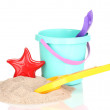 Childrens beach toys and sand isolated on white — Stock Photo #10430591