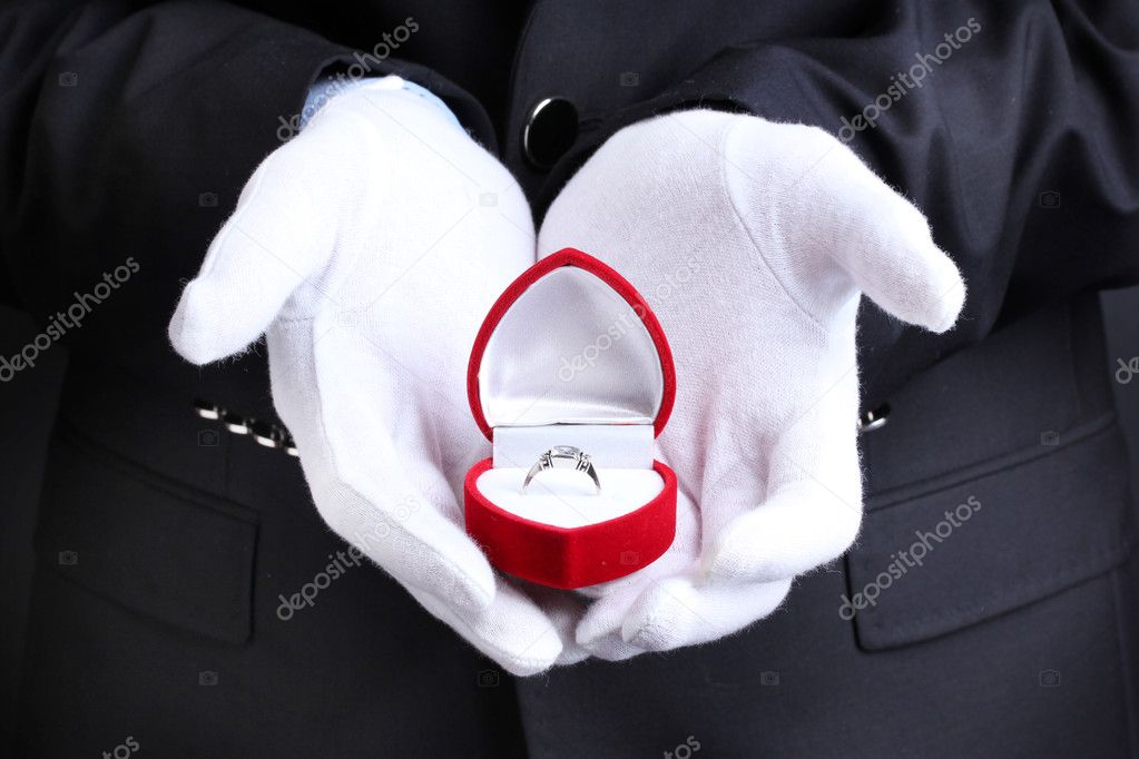 Mans hands holding ring in box — Stock Photo #10430482
