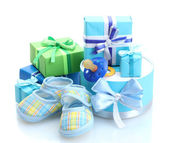 Beautiful gifts, babys bootees and dummy isolated on white — Stock Photo