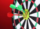 Darts with stickers depicting the life values close-up on colorful background — Stock Photo