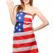 Beautiful young woman wrapped in American flag isolated on white — Stock Photo #10473485