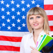 Young woman on the background of the flag of America — Stock Photo