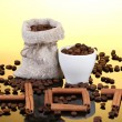 Composition of canvas sack and the cup with coffee beans on bright background. Hot. — Stock Photo #10474843
