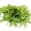 Fresh rucola salad or rocket lettuce leaves isolated on white — Stock Photo #10477508