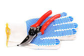 Pruner on garden gloves isolated on white — Stock Photo