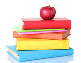 Composition of schoolbooks and an apple isolated on white — Stock Photo