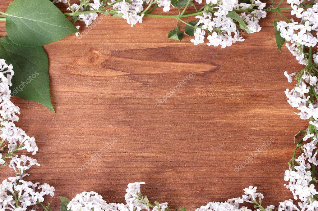 The frame of the branches of a lilac on wooden background  Stock Photo #10477448