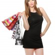 Beautiful young woman with shopping bags isolated on white — Stock Photo #10496422