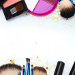 Make-up brushes in holder and cosmetics isolated on white — Stock Photo #10496518