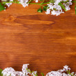 The frame of the branches of a lilac on wooden background — Stock Photo