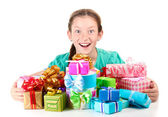 Little girl with gifts isolated on white — Stock Photo