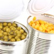 Open tin cans of corn and peas isolated on white — Stock Photo