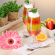 Fruit jelly in glasses and fruits on table in cafe — Stock Photo #10507770