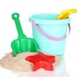 Childrens beach toys and sand isolated on white — Stock Photo #10507923